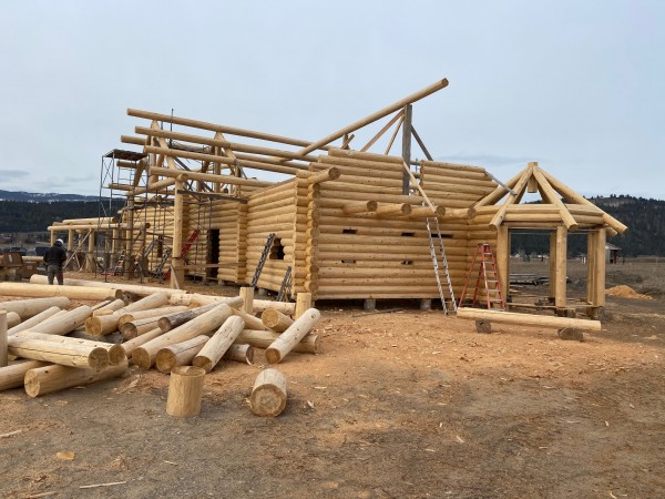Full scribe log home under construction.