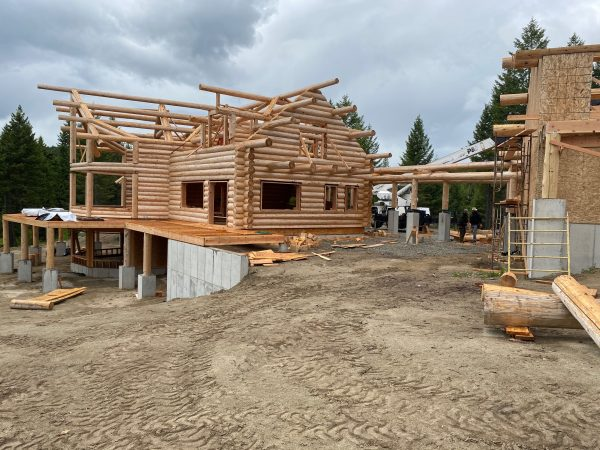 The stick framed garage will have log siding and pacman logs to tie in with the handcrafted log home.