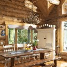 Log home dining room with custom picnic table and white cabinet