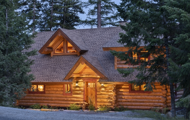 Evening picture of a handcrafted log home.