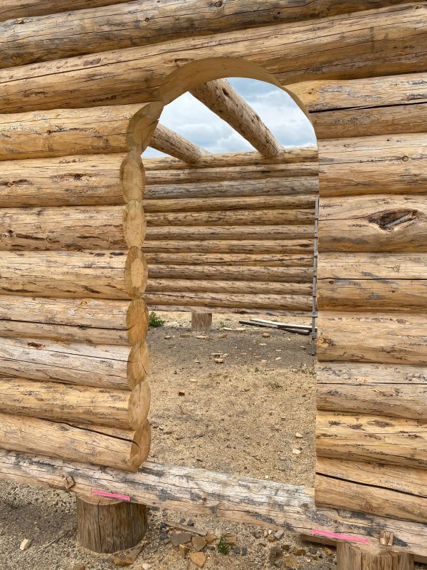 A log arch is cut into this custom full scribe log package.
