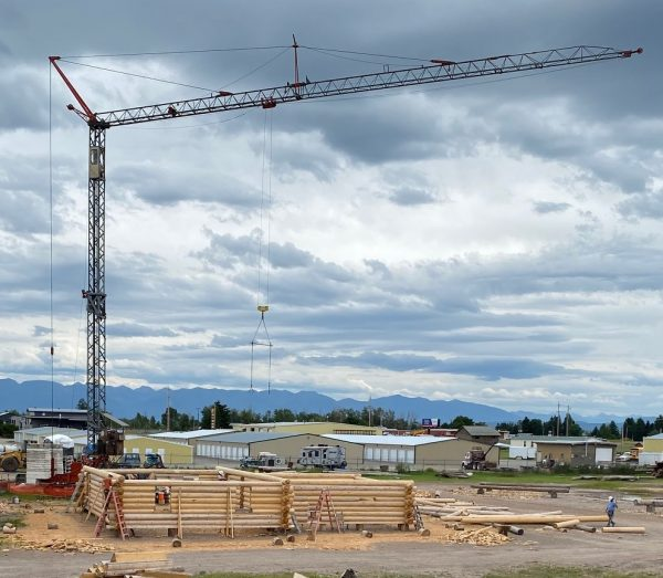 A tower crane looms over the custom log package. A key piece of equipment when building with full length logs.